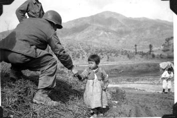 Korean War Soldier and Child