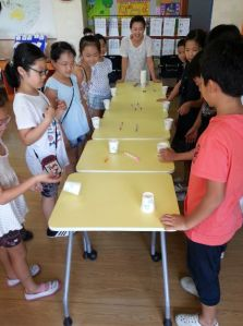 Teacher playing flip-cup with students.