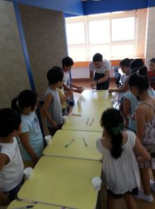 Students learning to play English flip-cup.