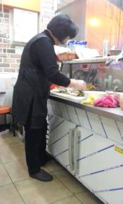 Ajumma working in kimbap shop