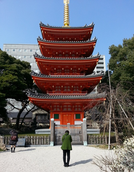 Woman worshiping Fukuoka Japan Buddhist Temple Entrance